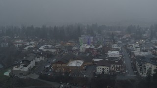 DX0002_227_023 - 5.7K stock footage aerial video of circling Christmas trees as it snows, Leavenworth, Washington