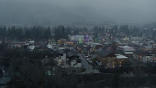 DX0002_227_029 - 5.7K stock footage aerial video of orbiting the town with Christmas trees, Leavenworth, Washington