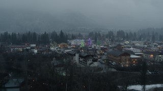 DX0002_227_030 - 5.7K stock footage aerial video of tall Christmas trees in the center of town, Leavenworth, Washington