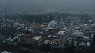 DX0002_227_031 - 5.7K stock footage aerial video of an orbit of tall Christmas trees in the center of town, Leavenworth, Washington