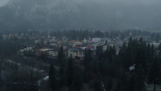 DX0002_227_032 - 5.7K stock footage aerial video of tall Christmas trees in the center of town while descending, Leavenworth, Washington