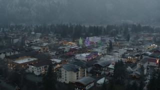 DX0002_227_034 - 5.7K stock footage aerial video stationary view of tall Christmas trees at the center of town, Leavenworth, Washington