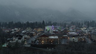 DX0002_227_037 - 5.7K stock footage aerial video of ascending past tall Christmas trees at the center of town, Leavenworth, Washington