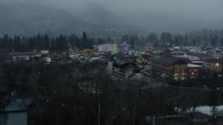 DX0002_227_038 - 5.7K stock footage aerial video of orbiting town while focused on tall Christmas trees, Leavenworth, Washington