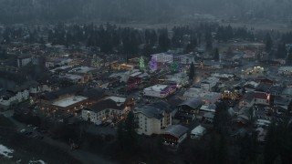 DX0002_227_039 - 5.7K stock footage aerial video of circling town while focused on tall Christmas trees, Leavenworth, Washington