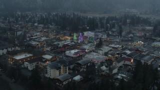 DX0002_227_040 - 5.7K stock footage aerial video orbit town while focused on tall Christmas trees, Leavenworth, Washington