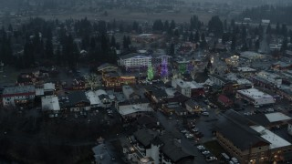 DX0002_227_041 - 5.7K stock footage aerial video circling above town while focused on Christmas trees, Leavenworth, Washington