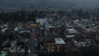 DX0002_227_045 - 5.7K stock footage aerial video circling a small town while focused on Christmas trees and lights, Leavenworth, Washington