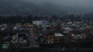 DX0002_227_051 - 5.7K stock footage aerial video orbiting a small town decorated with Christmas trees and lights, Leavenworth, Washington