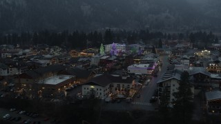 DX0002_227_053 - 5.7K stock footage aerial video of a small town decorated with Christmas trees and lights, Leavenworth, Washington