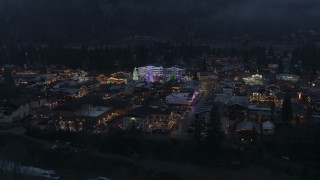 DX0002_228_001 - 5.7K stock footage aerial video of orbiting a small town with Christmas trees and lights at twilight, Leavenworth, Washington