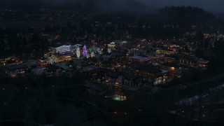 DX0002_228_008 - 5.7K stock footage aerial video circling Christmas trees and lights at night in Leavenworth, Washington
