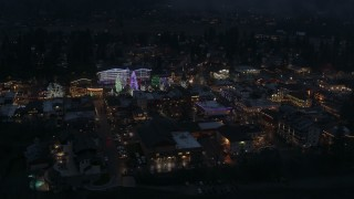 DX0002_228_010 - 5.7K stock footage aerial video of flying around Christmas trees and lights at night in Leavenworth, Washington
