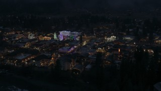 DX0002_228_011 - 5.7K stock footage aerial video orbit and fly away from Christmas trees and lights at night in Leavenworth, Washington