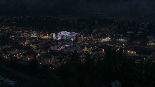 DX0002_228_012 - 5.7K stock footage aerial video of slowly approaching Christmas trees and lights at night in Leavenworth, Washington