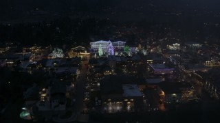 DX0002_228_015 - 5.7K stock footage aerial video slowly orbit town with Christmas trees and lights at night in Leavenworth, Washington