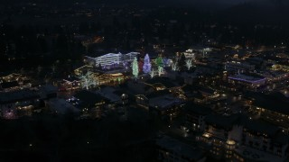 DX0002_228_017 - 5.7K stock footage aerial video of orbiting Christmas trees and lights at night in Leavenworth, Washington