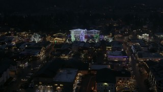 DX0002_228_018 - 5.7K stock footage aerial video of Christmas trees and lights at night in Leavenworth, Washington