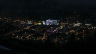 DX0002_228_022 - 5.7K stock footage aerial video slowly fly around Christmas trees and lights at night, Leavenworth, Washington