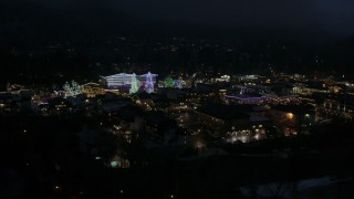 DX0002_228_023 - 5.7K stock footage aerial video slowly flying around Christmas trees and lights at night, Leavenworth, Washington