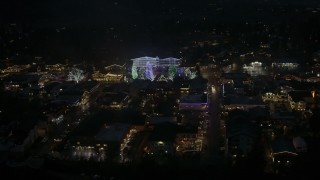 DX0002_228_026 - 5.7K stock footage aerial video circling trees and buildings with Christmas lights at night, Leavenworth, Washington