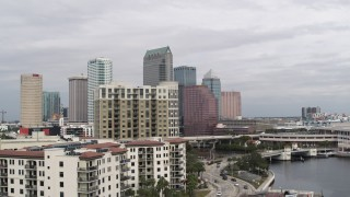 DX0003_229_004 - 5.7K stock footage aerial video fly away from tall skyscrapers, descend by apartments in Downtown Tampa, Florida
