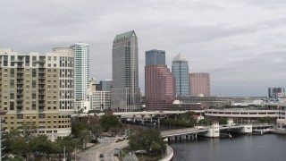 DX0003_229_005 - 5.7K stock footage aerial video fly low around apartments, reveal tall skyscrapers, Downtown Tampa, Florida