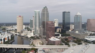 DX0003_229_006 - 5.7K stock footage aerial video of flying away from skyscrapers, Downtown Tampa, Florida
