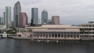 DX0003_229_013 - 5.7K stock footage aerial video orbit the convention center, skyline in background, Downtown Tampa, Florida