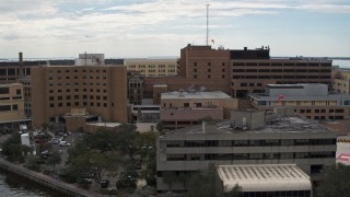 DX0003_229_016 - 5.7K stock footage aerial video of orbiting a hospital in Tampa, Florida