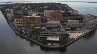 DX0003_229_018 - 5.7K stock footage aerial video of a reverse view of a waterfront hospital in Tampa, Florida