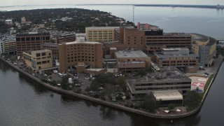 DX0003_229_019 - 5.7K stock footage aerial video of circling a waterfront hospital in Tampa, Florida