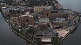 DX0003_229_021 - 5.7K stock footage aerial video approach and orbit a waterfront hospital complex in Tampa, Florida