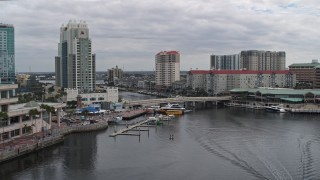 DX0003_229_027 - 5.7K stock footage aerial video approach condo complexes by a channel in Tampa, Florida