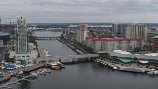 DX0003_229_028 - 5.7K stock footage aerial video reverse view of condo complexes by a channel in Tampa, Florida