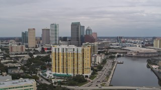 DX0003_229_030 - 5.7K stock footage aerial video flyby condo complex with view of Downtown Tampa, Florida