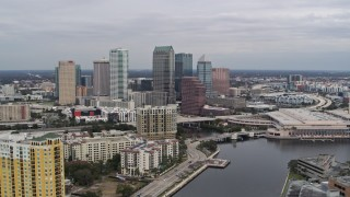 DX0003_229_034 - 5.7K stock footage aerial video stationary view of skyline from a channel, Downtown Tampa, Florida