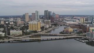 DX0003_229_043 - 5.7K stock footage aerial video of flying by bridges and channel while focused on skyline, Downtown Tampa, Florida