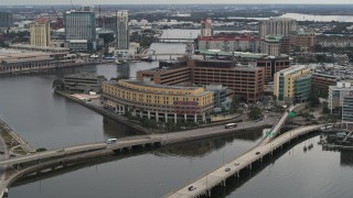 DX0003_230_004 - 5.7K stock footage aerial video reverse view of bridges and a waterfront hospital in Tampa, Florida