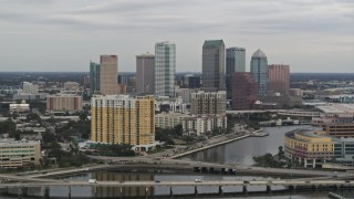 DX0003_230_007 - 5.7K stock footage aerial video of the skyline seen while passing bridges and channel, Downtown Tampa, Florida