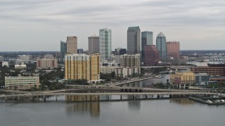DX0003_230_008 - 5.7K stock footage aerial video of the skyline, revealing bridges and channel, Downtown Tampa, Florida