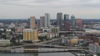 DX0003_230_009 - 5.7K stock footage aerial video of the skyline, seen from bridges and channel near condos, Downtown Tampa, Florida