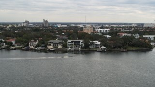 DX0003_230_016 - 5.7K stock footage aerial video of flying by waterfront mansions in Tampa, Florida