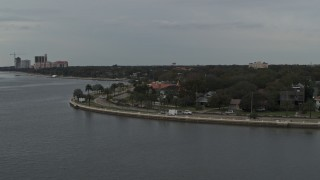 DX0003_230_018 - 5.7K stock footage aerial video of waterfront homes and city streets in Tampa, Florida