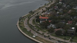 DX0003_230_020 - 5.7K stock footage aerial video reverse view of waterfront homes and Bayshore Blvd in Tampa, Florida