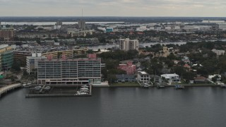 DX0003_230_021 - 5.7K stock footage aerial video of passing by waterfront mansions and condo complex in Tampa, Florida