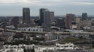 DX0003_230_024 - 5.7K stock footage aerial video of passing by the downtown skyline, Downtown Tampa, Florida