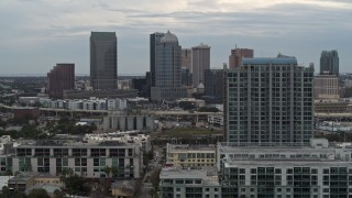 DX0003_230_027 - 5.7K stock footage aerial video of flying by apartment complex, reveal skyline, Downtown Tampa, Florida