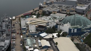 DX0003_230_030 - 5.7K stock footage aerial video reverse view of a warship museum and aquarium in Tampa, Florida
