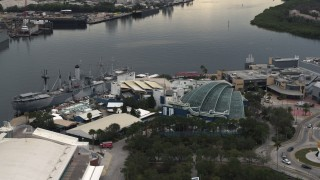 DX0003_230_032 - 5.7K stock footage aerial video of orbiting a warship museum and aquarium in Tampa, Florida